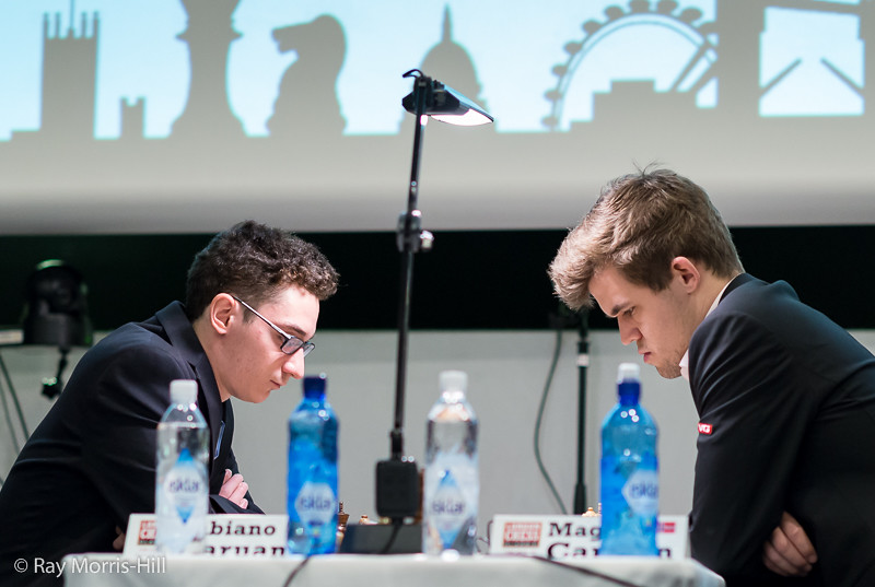 Round 2: Magnus Carlsen (right) vs Fabiano Caruana